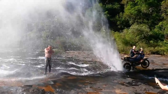 Motorcycle Provides Shower for Man in River